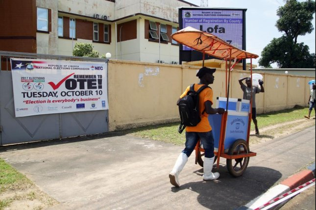 Election banners are seen in Liberia as voters in the African nation prepared to vote Tuesday to replace Africa's first female president -- and Liberia's first democratically elected president -- Ellen Johnson Sirleaf. Photo by Ahmed Jallanzo/EPA