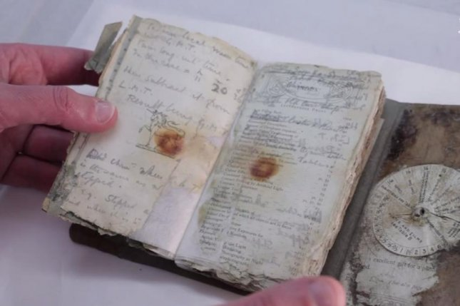 A notebook frozen in ice for 100 years. (New Zealand Antarctic Heritage Trust)