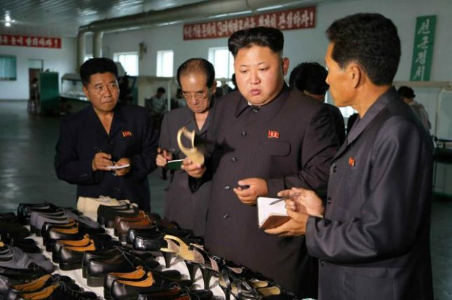 Kim Jong Un visited a state-owned shoe factory that he's visited four times since November 2015, according to North Korea media. File Photo by Rodong Sinmun
