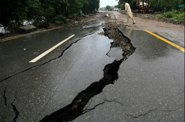A man inspects a damaged road Wednesday after a 5.8-magnitude earthquake, in Mirpur, Kashmir, Pakistan, that struck Tuesday. Photo by Rahat Dar/EPA-EFE