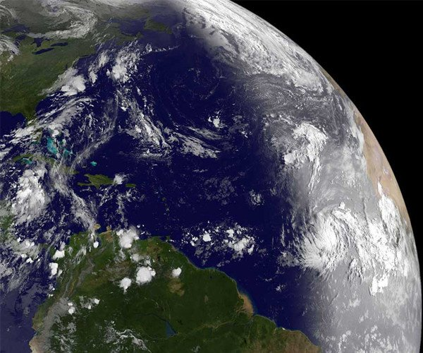 GOES-13 passed over Katia (right, center) on August 30, just after daylight reached it in the Atlantic, it revealed a well-developed storm. The bright vertical line on the Earth shows daylight to the east of the line, and imagery is visible. To the left of the line the earth is still in darkness, and infrared imagery shows where the clouds are located. Credit: NASA/NOAA GOES Project