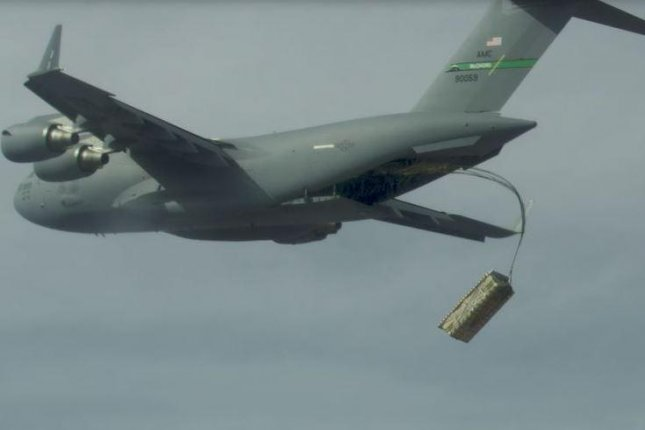 A high-altitude airdrop of pallets of simulated missiles from a U.S. Air Force C-17 cargo plane was conducted in September, and Lockheed Martin on Wednesday announced a $25 million contract to continue work on the concept. Photo courtesy of U.S. Air Force