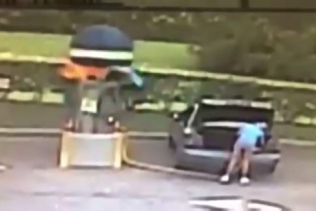 A vacuum explodes at the Shuttle Car Wash in Titusville, Fla., while a woman uses it to clean gasoline out of her trunk. Screenshot: WKMG-TV/Facebook