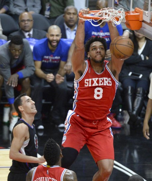 Philadelphia 76ers big man Jahlil Okafor throws down a dunk in a game against the Los Angeles Clippers. Photo by Mike Nelson/EPA
