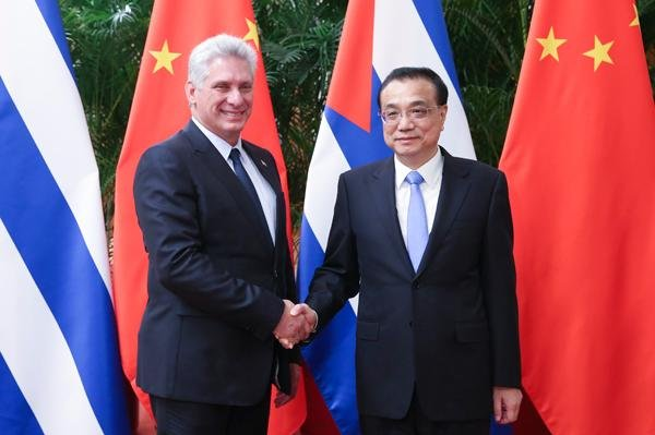 Cuban President Miguel Diaz Canel (L) shakes hands with Chinese premier Li Keqiang on Thursday, on the last of a three-day visit to China. Photo courtesy the People's Republic of China