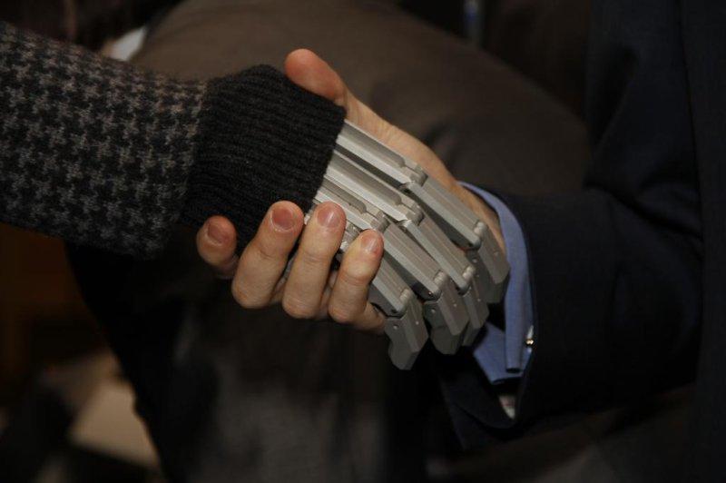 Robot handshake. (Credit: Global Futures 2045)