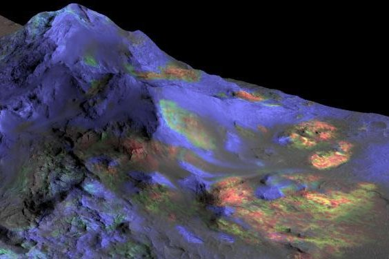 A rendering shows newly analyzed CRISM data overlaid on a 3-D image of Mars' surface. The green represents the spectral signature of impact glass. Photo by NASA/JPL-Caltech/JHUAPL/University of Arizona
