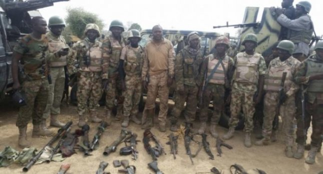 Nigerian Army troops pose with armaments taken in a Feb. 1 attack on a Boko Haram camp. United Nations envoy Jeffrey Feltmen told the Security Council on Tuesday that Boko Haram is running out of funding. Photo by HQ Nigerian Army/Facebook