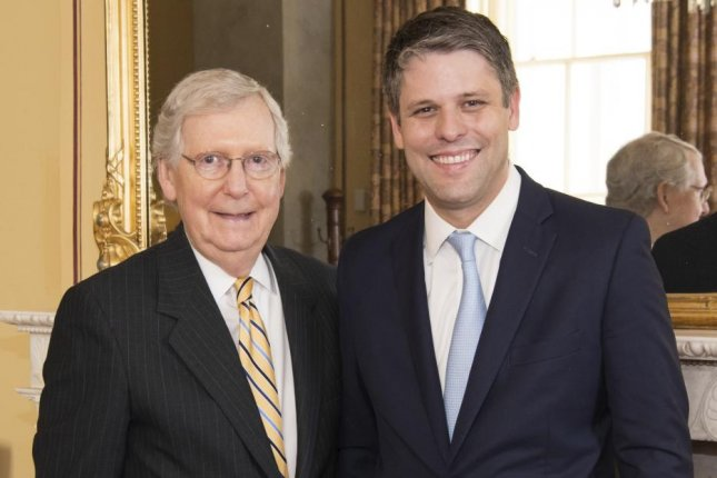 Senate Republican leader Mitch McConnell (L) is pictured with U.S. District Court judge Justin Walker before his Senate confirmation in October 2019. Photo courtesy Sen. Mitch McConnell's Office/UPI
