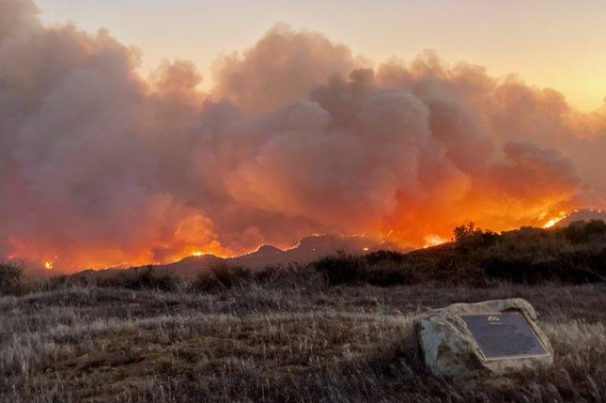 California wildfire prompts highway closure, evacuations