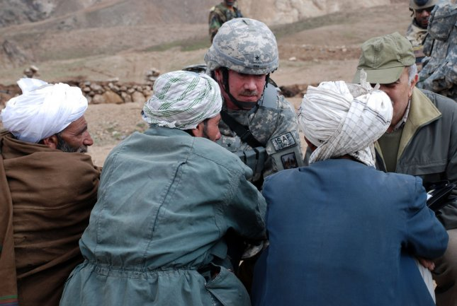 Herat Afghanistan, Feb 20 – Gen. Michael Ryan, of U.S. Forces-Afghanistan, offers his condolences to families of those civilians killed during an air-strike aimed at an insurgent leader, Feb.17, 2009. Photo provided by the U.S. military.