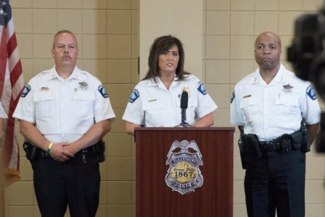 Minneapolis police Chief Janee Harteau (C) gives a press conference on the officer-involved shooting death of an Australian woman. Harteau resigned from the force Friday. Photo courtesy of the Minneapolis Police Department