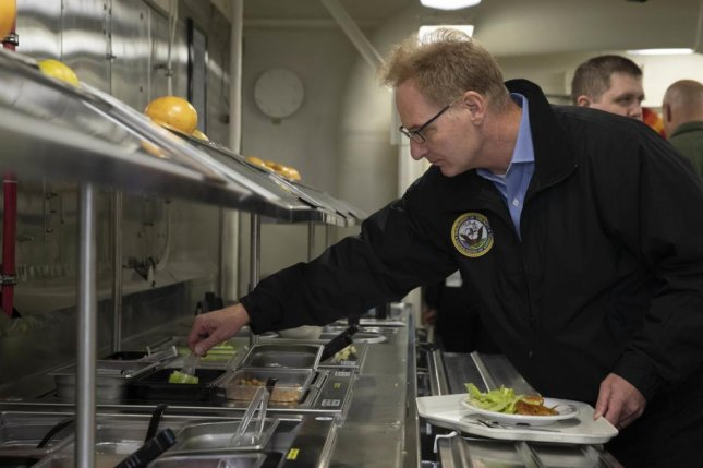Acting Secretary of the Navy Thomas Modly selects items from the salad bar in USS Gerald R. Ford's main galley. Modly visited the Ford Tuesday to meet with sailors and be briefed on Ford's progress following its post-shakedown availability and recent independent steaming exercise, as part of his first official visit to the fleet. Photo by Brigitte Johnston/U.S. Navy