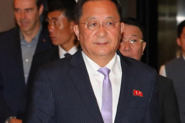 North Korean Foreign Minister Ri Yong Ho enters a hotel after flying in to attend the ASEAN Regional Forum, in Singapore, on Friday. Photo by Yonhap