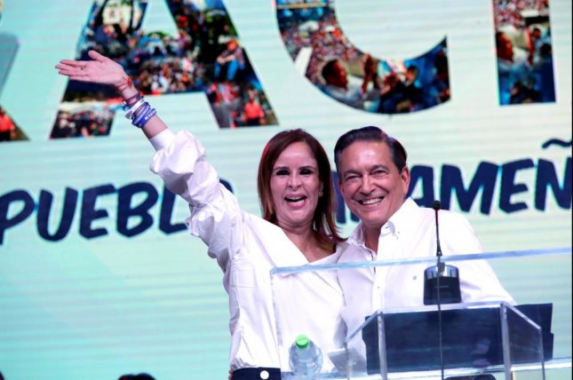 Panamanian presidential candidate Laurentino Cortizo celebrates with his wife, Yasmin de Cortizo, after election results showed he had a 2-point lead on his opponent. Photo by Bienvenido Velasco/EPA-EFE