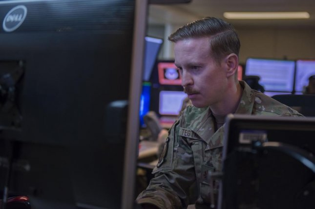 U.S. Air Force Maj. Christopher Tegmeyer of the 727th Expeditionary Air Control Squadron monitors information during Air Missile and Defense Exercise 21-1 at Al Dhafra Air Base, United Arab Emirates, in October. Photo by Staff Sgt. Zade Vadnais/U.S. Air Force