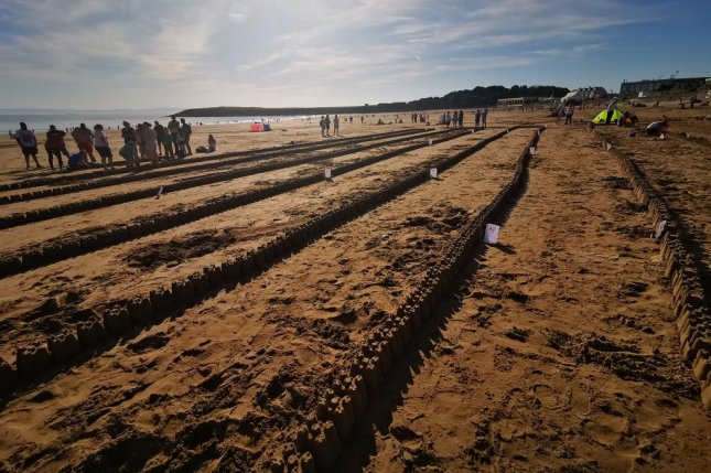 A Welsh community group built 2,044 sandcastles on a beach to break a Guinness World Record. Photo courtesy of Beautiful Barry