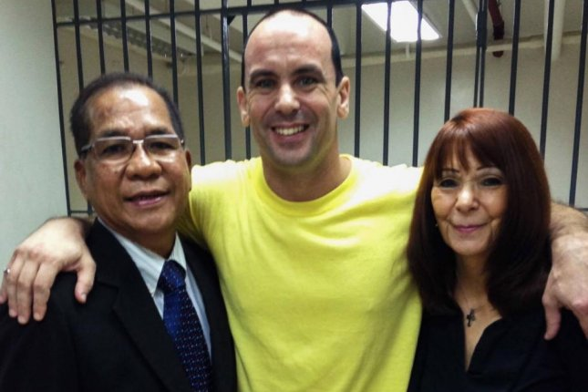 Scott McMahon (C) Seattle-area man who has been imprisoned in the Philippines for five years, was acquitted of all rape charges on Tuesday by a Manila judge who ruled the woman who accused McMahon of rape filed a false accusation in retaliation. Photo courtesy of Freedom for Scott McMahon