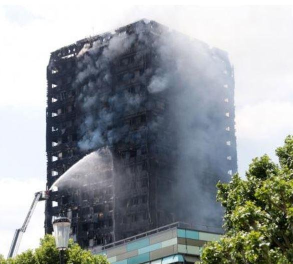 Hundreds of buildings in Britain have exterior cladding similar to that on London's Grenfell Tower, which burned ion June 14, British Prime Minister Theresa May said Thursday. She ordered testing of materials on similar buildings. Photo by Hugo Philpott/UPI