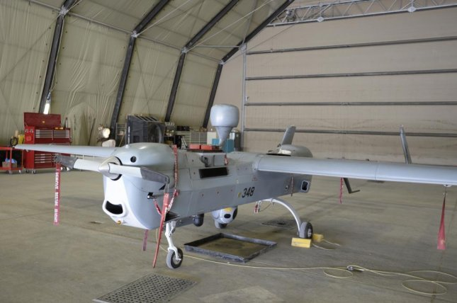 A MQ-5B Hunter unmanned aircraft stands ready in a Task Force Copperhead Tactical Unmanned Aerial Vehicle Detachment hangar at Kandahar Airfield, Afghanistan, August 6, 2015. U.S. Navy photo by Lt. Kristine Volk