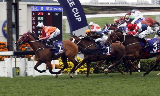 Helene Paragon wins Sunday's Group 1 Queen's Silver Jubilee Cup in Hong Kong as trainer John Moore enjoys a great day. (HKJC Photo)