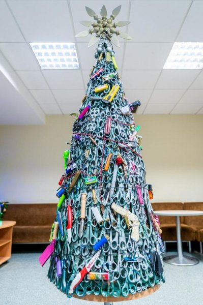 An Airport in Lithuania is celebrating the holidays by creating a Christmas tree out of prohibited items confiscated by security. Photo courtesy of Lithuanian Airports