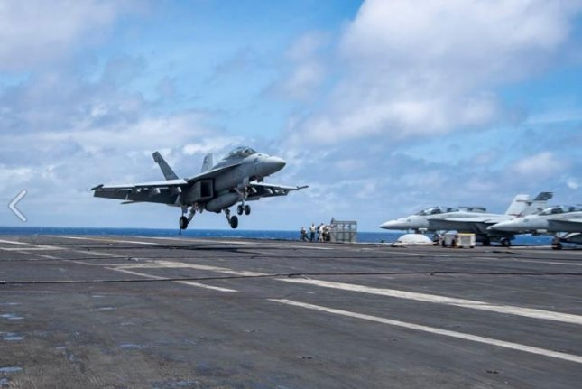 A fighter plane lands aboard the aircraft carrier USS Harry S. Truman. Photo courtesy of USS Harry S. Truman/U.S. Navy/Facebook