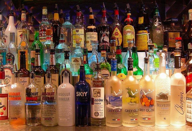 Liquor bottles at a bar. (CC/Sean)