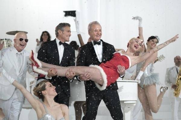 Paul Shaffer, George Clooney, Bill Murray and Miley Cyrus in A Very Murray Christmas. Photo courtesy of Netflix