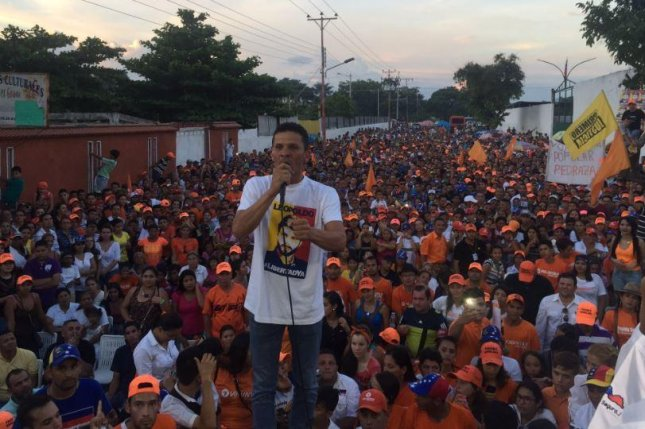Gilber Caro, a member of Venezuela's National Assembly representing Miranda state, seen here speaking to supporters, was arrested on Wednesday on charges that he attempted to instigate anti-government violence. The Venezuelan opposition has criticized the arrest. Photo courtesy of Gilber Caro