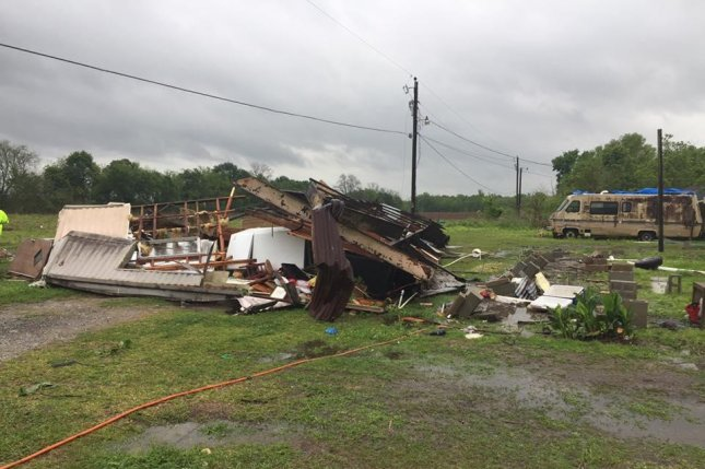 A 38-year-old woman and her 3-year-old daugther died on Sunday after a tornado flipped their mobile home in Louisiana during a thunderstorm that was part of severe weather in the U.S. Southeast. A person died in South Carolina in a similar scenario, officials said. Photo courtesy St. Martin Parish Sheriff's Office