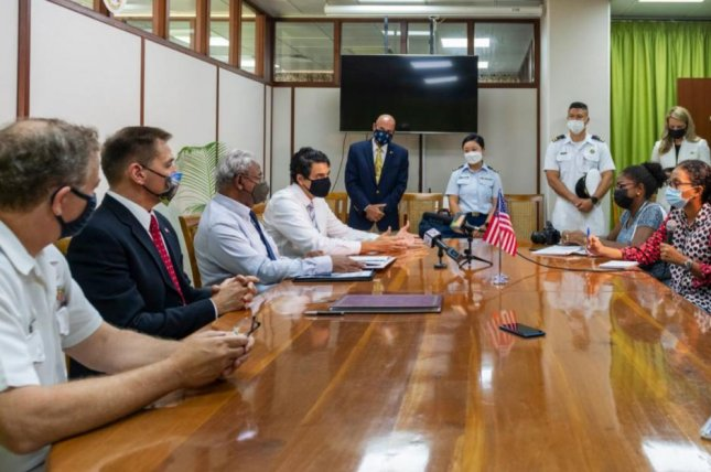Representatives of the United States and Seychelles met at Port Louis, Seychelles, on Tuesday to sign a bilateral agreement to counter illicit maritime operations in the Indian Ocean. Photo courtesy of U.S. 6th Fleet