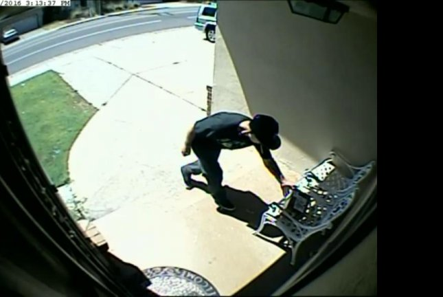 A California package thief makes off with a box of dog poop. Screenshot: WFXT-TV