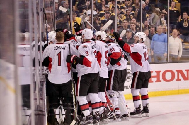 Teammates mob Clarke MacArthur after his goal gave the Senators the series win. Photo courtesy Ottawa Senators via Twitter
