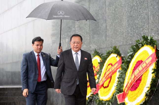 North Korean Foreign Minister Ri Yong Ho (R) attends a wreath-laying ceremony at the mausoleum of Vietnamese late President Ho Chi Minh in Hanoi, Vietnam, on Saturday. Photo by Luong Thai Linh/Pool