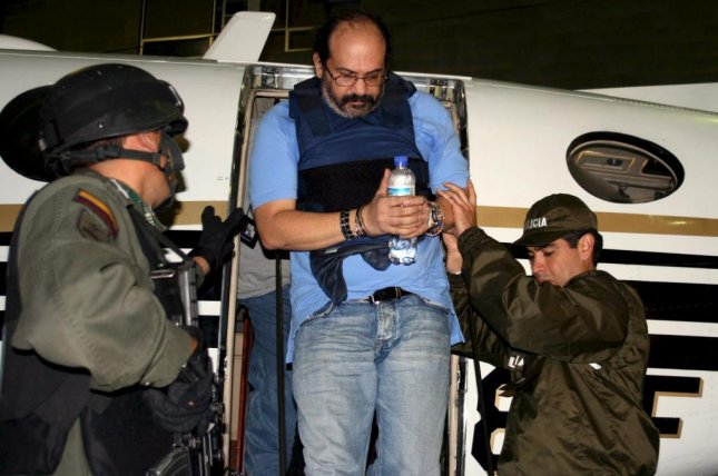 The son of former warlord Rodrigo Tovar, shown here under arrest in Bogota, Colombia May 13, 2008, was named to lead a program to compensate victims of the country's long civil war Tovar was part of. Photo by Colombia National Police/EPA
