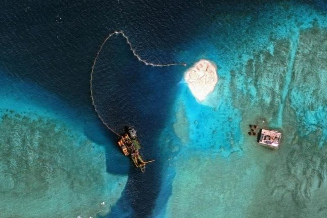 A satellite image of Mischief Reef in the disputed Spratly Islands in the South China Sea showed China had made signifcant progress reclaiming land on coral reefs. File Photo courtesy of CSIS Asia Maritime Transparency Initiative / DigitalGlobe