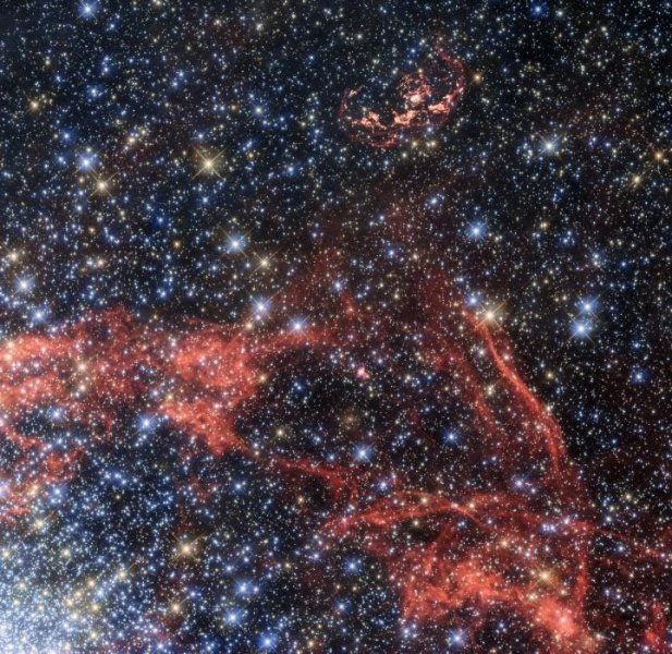 This image, taken with the Hubble Space Telescope, shows the supernova remnant SNR 0509-68.7, also known as N103B, which is seen at the top of the image. N103B was a Type Ia supernova, located in the Large Magellanic Cloud -- a neighboring galaxy of the Milky Way. Astronomers are analyzing the supernova remnants to search for a potential stellar survivor to possibly confirm a theory. Photo by Hubble/ESA/NASA