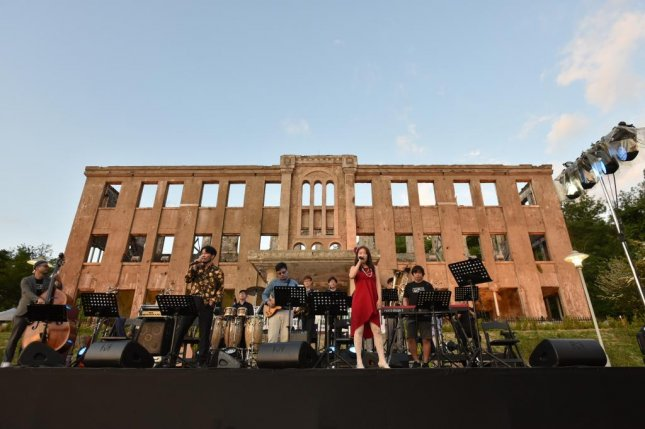 "The ""Friendship Concert"" kicks off the DMZ Peace Train Music Festival in front of the old Workers' Party of Korea headquarters in Cheorwon County, Gangwon Province, on Friday. Photo courtesy of DMZ Peace Train Music Festival"