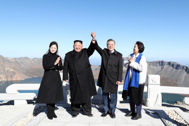 Image result for Moon Jae-in, Kim Jong Un, photo, lake,
