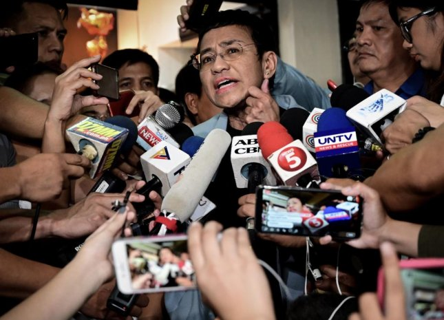 Maria Ressa, CEO and executive editor of online news site Rappler, speaks to media after posting bail on her cyber libel case at a local court in Manila, the Philippines. Photo by Alecs Ongcal/EPA-EFE