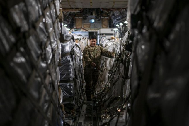 Staff Sgt. Dwayne Baldwin, 701st Airlift Squadron loadmaster, inspects cargo before departing to Johan Adolf Pengel International Airport, Suriname from Joint Base Charleston, S.C. on Friday. Photo by Staff Sgt. Shawn White/U.S. Air Force