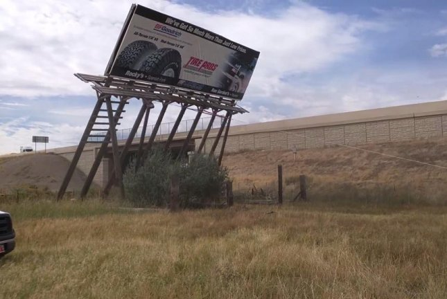 A Utah man used a truck to pull down this billboard. Sully222/YouTube video screenshot