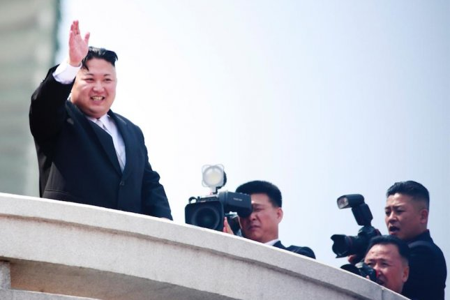 North Korean leader Kim Jong Un (L) waves during a parade for the Day of the Sun festival on Kim Il Sung Square in Pyongyang, North Korea, on April 15. File Photo How Hwee Young/EPA