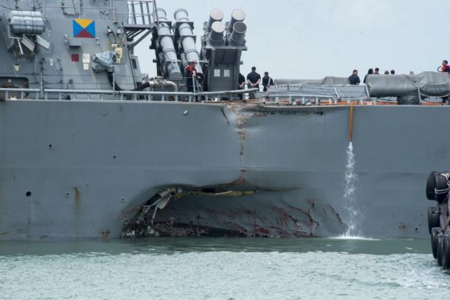 The USS John S. McCain, pictured after colliding with a merchant vessel in August, will be repaired in Japan, the U.S. Navy announced on Wednesday. U.S. Navy photo by Mass Communication Specialist 2nd Class Joshua Fulton