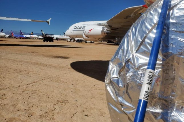 Australian airline Qantas is using broom handles repurposed as wheel whackers to prevent engineers maintaining jets in California's Mojave Desert from running afoul of rattlesnakes. Photo courtesy of Qantas