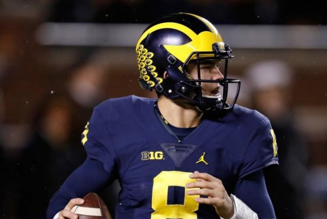 No. 7 Michigan will start senior John O'Korn (8) at quarterback with Wilton Speight sidelined for multiple weeks because of injury, coach Jim Harbaugh said Monday. Photo courtesy of Michigan Football/Twitter
