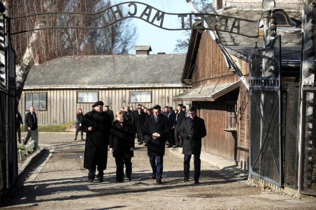 German Chancellor Angela Merkel (second from left) and Polish Prime Minister Mateusz Morawiecki (second from right) visit the Auschwitz-Birkenau Memorial and Museum in Oswiecim, Poland, on Friday. Photo by Lukasz Gagulski/EPA-EFE