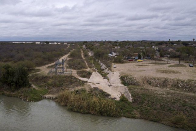 The federal government plans to assess this strip of land along the Rio Grande in Webb County as a potential site for the Trump administration's border wall expansion. Photo by  Miguel Gutierrez Jr./The Texas Tribune