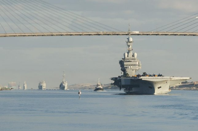 The French navy nuclear aircraft carrier Charles de Gaulle (R91) transits the Suez Canal, Dec. 7, 2015. French Navy photo